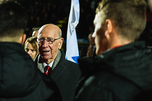 Sir Bobby Charlton meets players from the British Army team.