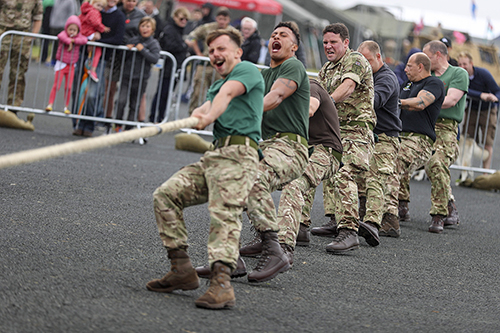 Commando Logistics Regiment Arned Forces Day Picture taken during the tug of war competition. Consent not held. Royal Marines Barracks Chivenor airfield, near Barnstaple, North Devon, has been open to the public today for a day of family fun in aid of North Devon Hospice and two military charities. To Mark Armed Forces Day on Saturday 24 June, the community were welcomed to enjoy a whole range of activities and displays. These included a climbing wall, military vehicle displays and a 999 road traffic collision demonstration.